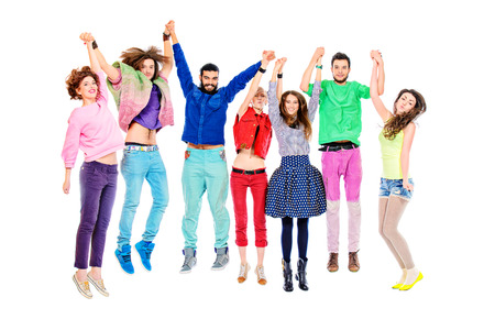 Large group of cheerful young people jumping for joy. Isolated over white. photo