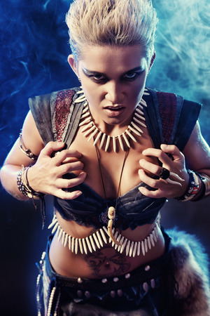 experienced: Portrait of a beautiful female warrior. Ancient times. Amazon. Stock Photo