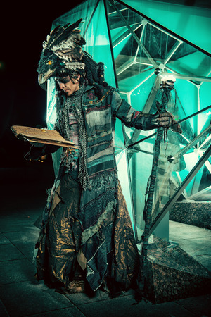 shaman: Portrait of a male shaman in ethnic dress on a background of a futuristic exterior. Fantasy concept, magic.