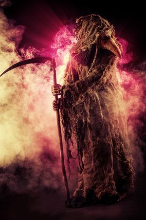 mystery man: Portrait of a terrible plague doctor with a scythe