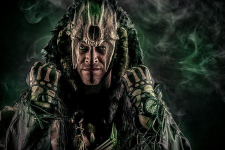 ritual: Ancient shaman warrior. Ethnic costume. Paganism, ritual.