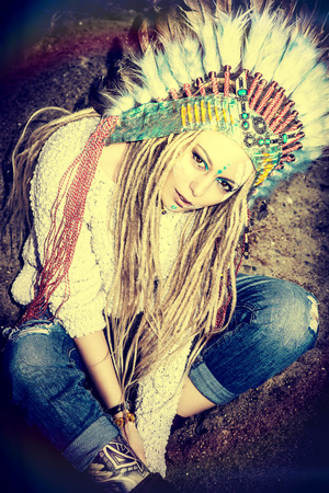 ceremonial make up: Fashion shot of a beautiful girl in style of the American Indians. Western style. Jeans fashion. Stock Photo