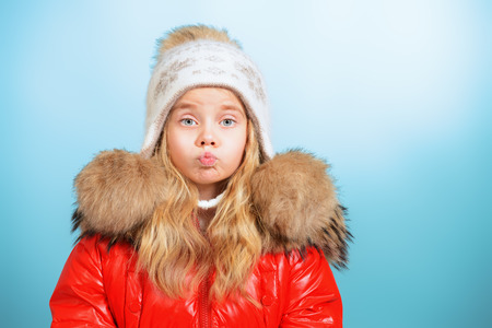 Pretty little girl in winter clothing. Childhood. Winter fashion.