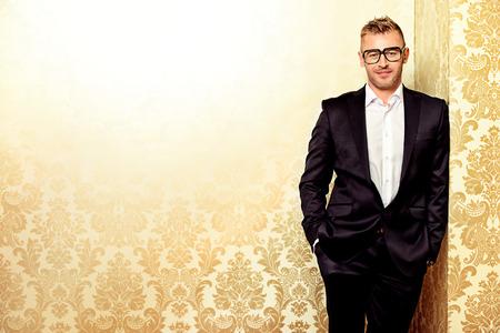 mature male: Portrait of a handsome mature man in elegant suit. Fashion, beauty. Stock Photo