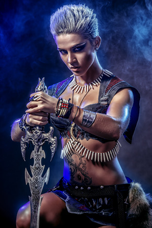 female warrior: Portrait of a beautiful female warrior in battle. Ancient times. Amazon. Stock Photo