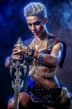 female warrior: Portrait of a beautiful female warrior in battle. Ancient times. Amazon. Stock Photo