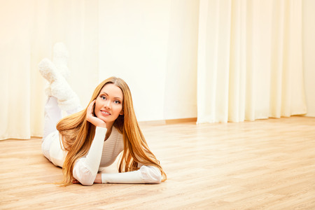 linoleum: Beautiful smiling young woman enjoying staying at home.