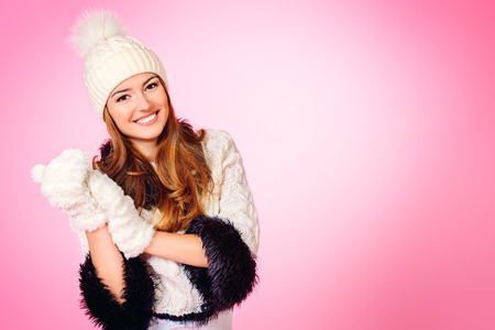 Joyful girl in warm knitted clothing smiling at camera. Beauty, fashion. Winter lifestyle. Copy space. photo