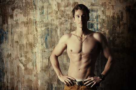 topless jeans: Young handsome man with beautiful muscular body. Mens beauty, healthcare.