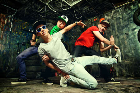 hip hop style: Modern dancers dancing in the garage. Urban lifestyle. Hip-hop generation.