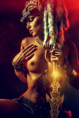 Close-up portrait of a beautiful nude Amazon in a mask. Ancient times. Fantasy. Ethnics. Stock Photo