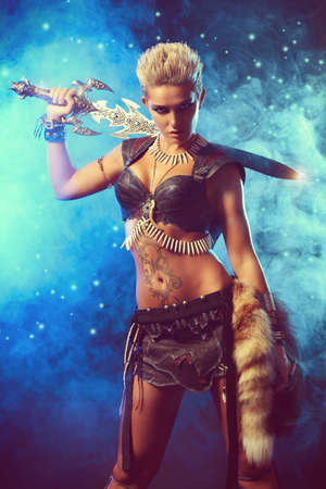 warrior: Portrait of a beautiful female warrior in battle. Ancient times. Amazon. Stock Photo
