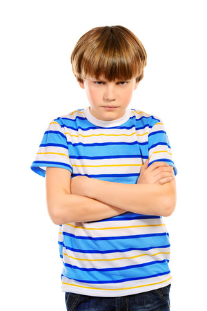 frown: Portrait of a ten years boy looking at camera seriously. Isolated over white.