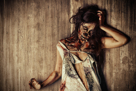 massacre: Close-up portrait of a scary bloody zombie girl. Horror. Halloween. Stock Photo