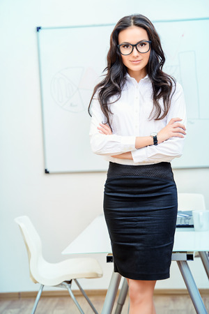 flip chart: Business woman making a presentation at the office.