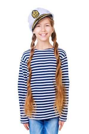striped vest: Joyful teen girl wearing sailors striped vest and marine cap. Studio shot. Isolated over white.