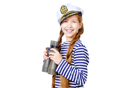 striped vest: Joyful teen girl wearing sailors striped vest and marine cap standing with binoculars. Studio shot. Isolated over white.