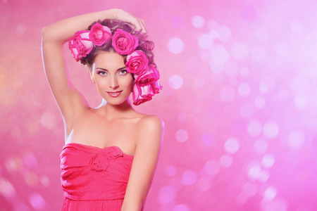 sexy lady: Beautiful tender girl with floral hairstyle. Roses. Cosmetics. Beauty, fashion. Spring and summer. Copy space. Stock Photo