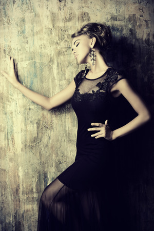 alluring: Stunning female model in black evening dress. Fashion shot.