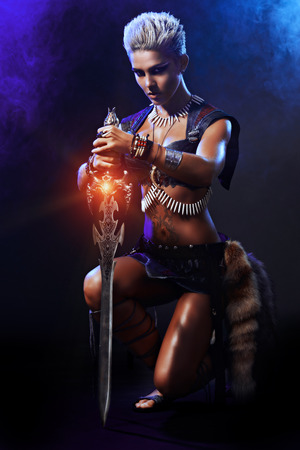 Portrait of a beautiful female warrior in battle. Ancient times. Amazon. Stock Photo