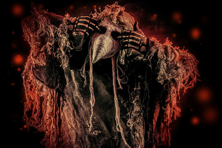 plague: Portrait of a terrible plague doctor with a scythe. Medieval Europe. Horror. Halloween. Stock Photo