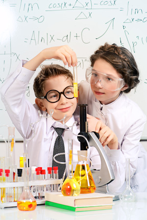 science lesson: Students doing experiments in the laboratory. Science and education. Stock Photo
