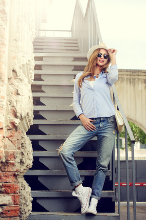 denims: Beautiful young woman in the city. Jeans style. Fashion. Stock Photo