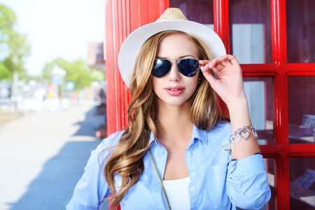 sunglass: Beautiful young woman walking in the city Stock Photo