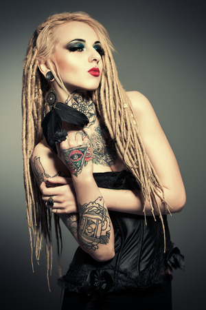 eye tattoo: Gorgeous girl with black make-up and long dreadlocks Stock Photo