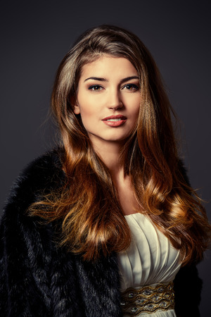 and the magnificent: Close-up portrait of a magnificent young woman wearing fur jacket