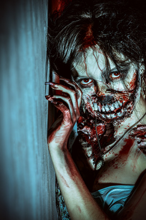 bloodthirsty: Close-up portrait of a scary bloody zombie girl. Horror. Halloween. Stock Photo