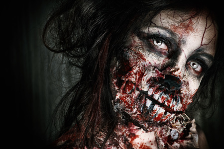 frightening: Close-up portrait of a scary bloody zombie girl. Horror. Halloween. Stock Photo