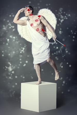 nackter junge: Full length portrait of a man angel Cupid posing like a statue. Valentines day. Love concept. Lizenzfreie Bilder