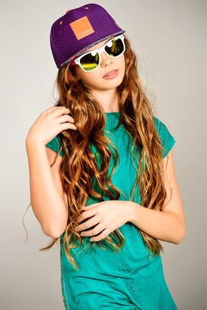 fashionable sunglasses: Portrait of a trendy teen girl. Fashion, lifestyle. Studio shot. Stock Photo