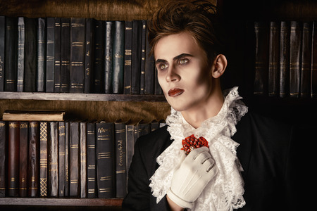 nobleman: Handsome vampire nobleman studying ancient books in the library