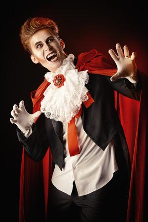 bloodthirsty: Handsome bloodthirsty vampire. Halloween. Dracula costume.