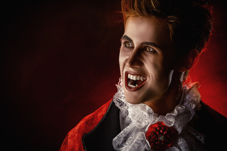 bloodthirsty: Handsome bloodthirsty vampire Stock Photo