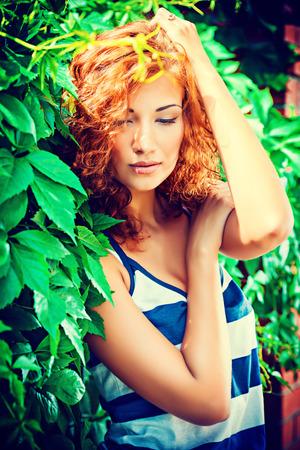 foxy: Pretty young woman beautiful foxy hair outdoors. Beauty, fashion. Stock Photo