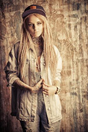 modern generation: Modern teenage girl with blonde dreadlocks. Jeans style. Modern generation.