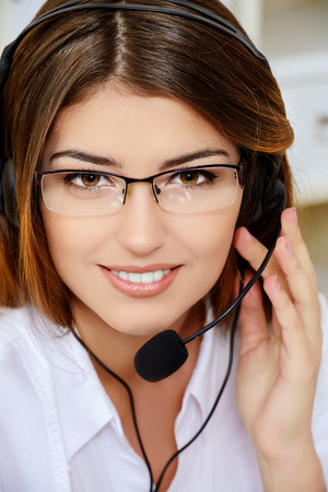 customer service phone: Friendly smiling young woman surrort phone operator at her workplace in the office. Headset. Customer service.