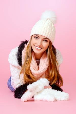 Joyful girl in warm knitted clothing smiling at camera. Beauty, fashion. Winter lifestyle. photo