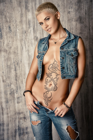 topless jeans: Sexual young woman in denim jeans and jacket. Beauty, fashion. Stock Photo