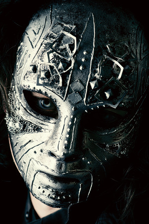 halloween mask: Portrait of a mysterious man in iron mask. Steampunk. Fantasy. Halloween.