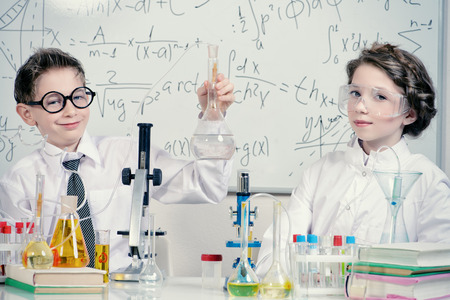 kid portrait: Students doing experiments in the laboratory. Science and education. Stock Photo