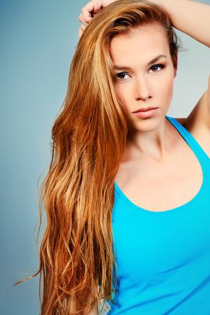 Beautiful girl with long hair. Hair care, healthy hair.