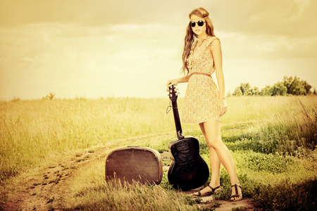 hippy: Romantic girl travelling with her guitar. Summer. Hippie style. Stock Photo