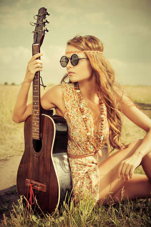 fit girl: Romantic girl travelling with her guitar. Summer. Hippie style. Stock Photo