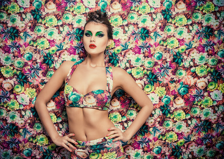 sexy breasts: Portrait of a sexual woman in lingerie over bright floral background. Beauty, fashion. Stock Photo