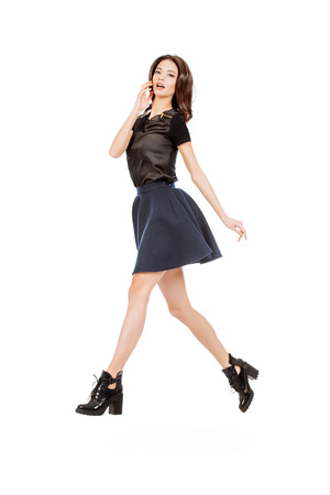model portrait: Fashion shot of an elegant female model posing at studio in motion. Beauty, fashion. Isolated over white.