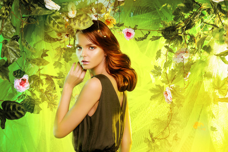 Beautiful young woman  among tropical plants and flowers. Beauty, fashion. Spa, healthcare. photo